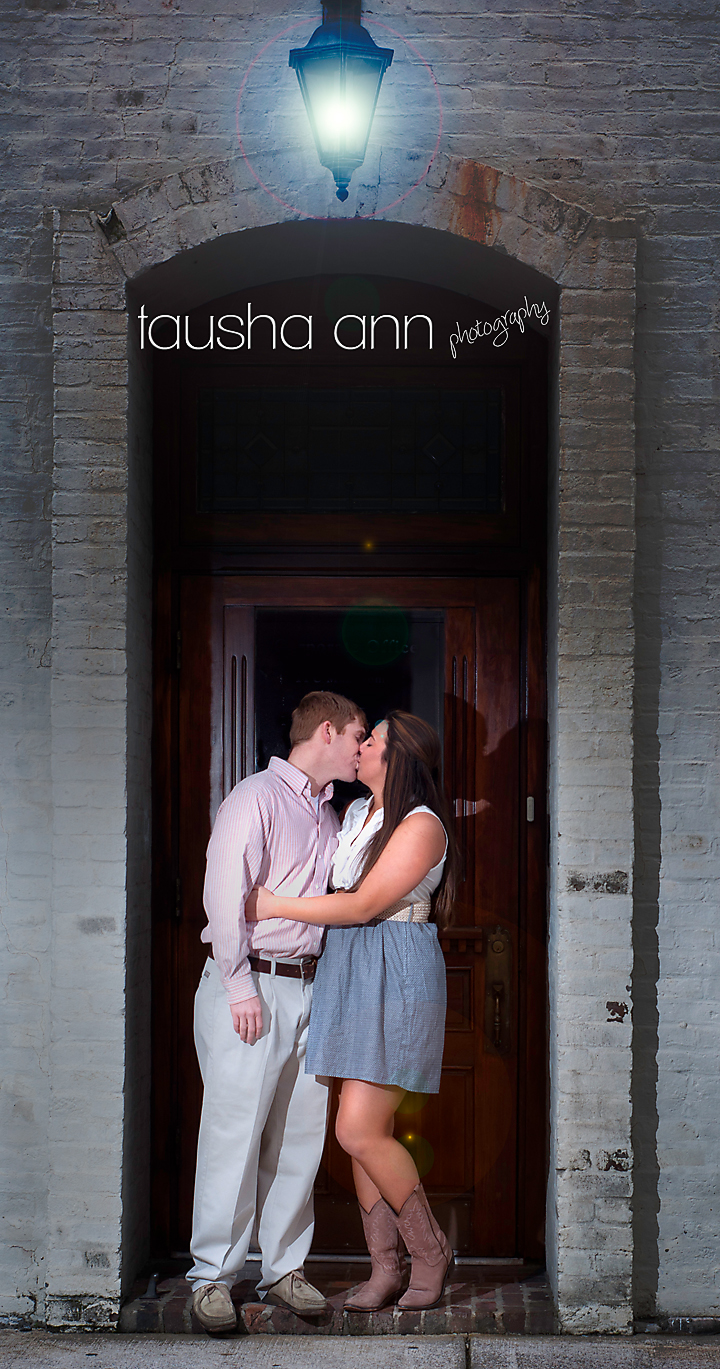 Couple Kissing Under light in doorway