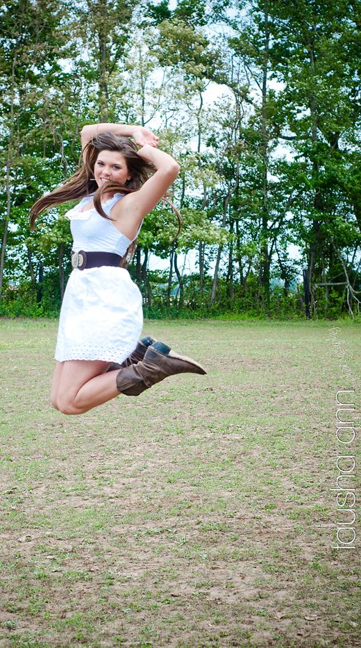 girl jumping in white dress cowboy boots fashion model senior photography nashville