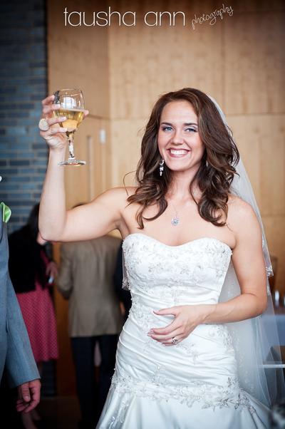 Bride with wine glass toast nashville wedding photographer
