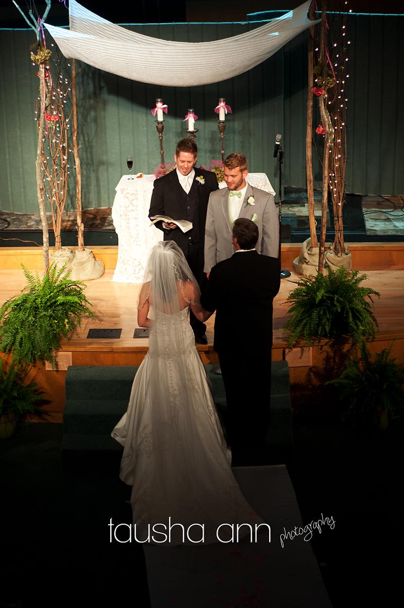 Bride - groom - dad- pastor - at the altar. Nashville TN Wedding Photographer