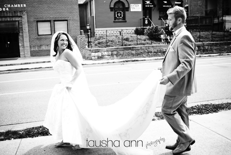 Sweet groom carryng brides dress train. Nashville TN Wedding Photography Belmont Church